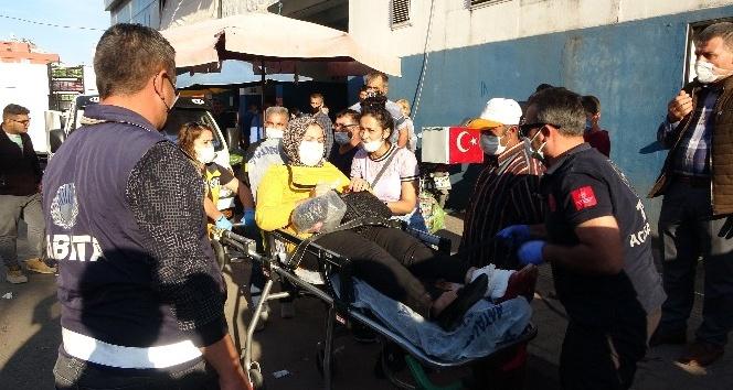 Pazar alışverişi sırasında silahlı kavganın arasında kalan kadın ayağından yaralandı